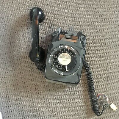 old fashioned wall mounted telephone