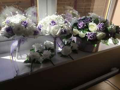 A selection of lilac and white beautiful silk flower arrangements