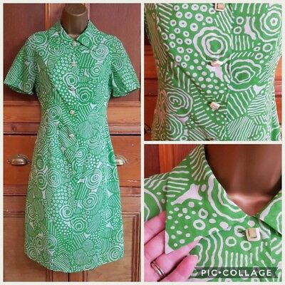 True vintage 1960s green dress with white swirl and strip design