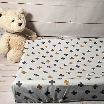 Change table cover in metallic gold and grey crosses swiss cross modern changing