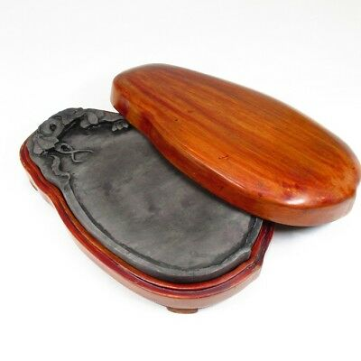 G378: Chinese calligraphy tools. An ink stone with sculpture and wooden case