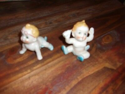 Vintage BISQUE Porcelain  Piano Baby Figurines lot of   2...must see ...