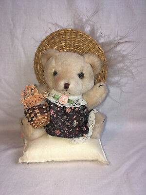 Lady Teddy in Dress and Feathered Hat on Cushion with basket of dried flowers