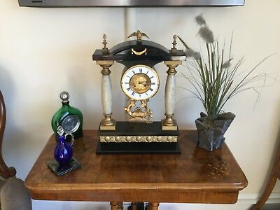 Antique clock   Is in working order