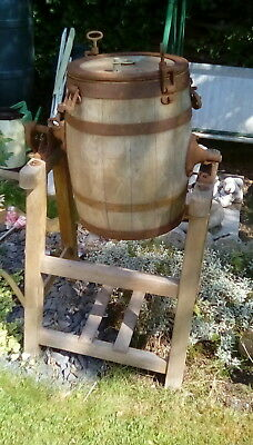 Old vintage wooden butter churn with stand