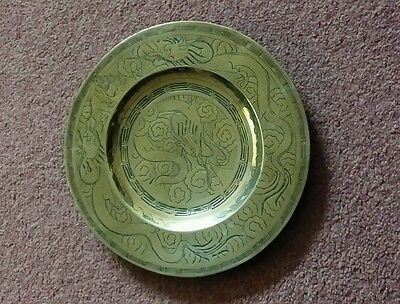 An early 20th century Chinese hand made solid brass plate