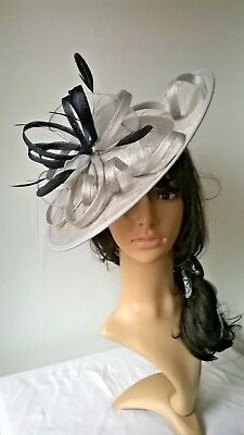 Silver Grey/ navy..sinamay & feather Hatinator shaped disc Wedding.races.new