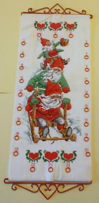 Swedish Xmas: Hand-cross-stitched Advent Calendar with santas, for small gifts