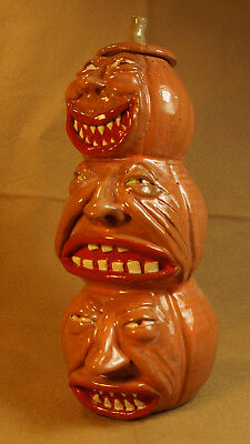 A RODY BUNCH OF PUMPKINS - Traditional Stacked Face Jug