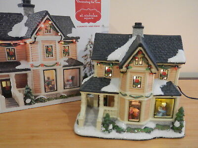St. Nicholas Square - Decorating The Tree Lighted House