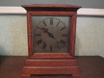 An old Winterhalder & Hofmeier oak mantel clock