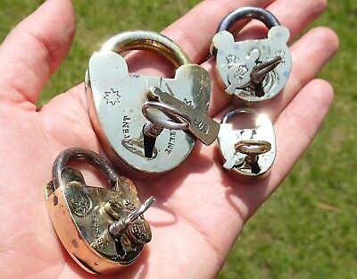 Collection of four good quality 19th Century British brass padlocks and keys