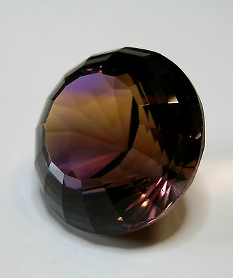 Natural earth-mined world class museum quality ametrine...72.9 carat