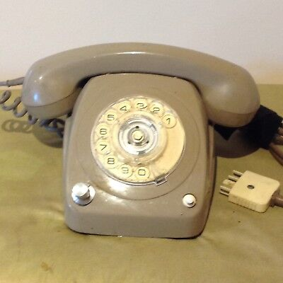 Old Rotary Dial Telephone with Amplifier.