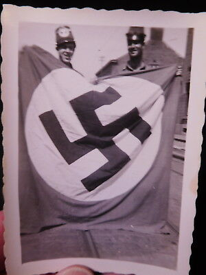 Original WWII photograph of U.S. Soldiers posing with Captured German Flag