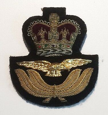 WW2 World War II RCAF officers peaked cap badge with gold bullion thread.