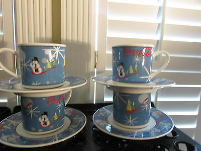 Coca Cola Laughing Snowman 4 Cups & Saucers