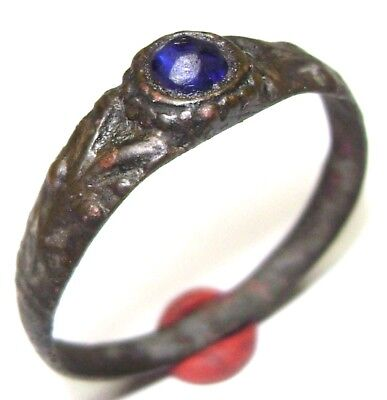 Ancient Medieval decorated bronze ring with blue stone.