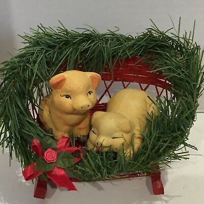 Two Ceramic Pigs in a Wooden Christmas Sled Decor