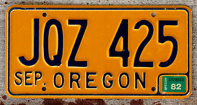 Classic Blue on Orange Oregon License Plate with a 1982 Sticker