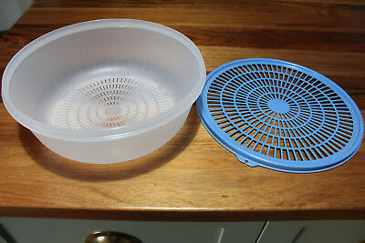 RetroTupperware Colander.Clear base, blue lid . Two piece.