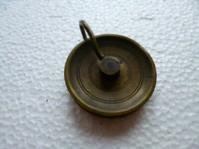 Vintage clock pulley wheel.
