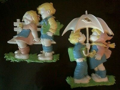 Dart brand vintage boy and girl wall decor set of 2. 12 inches tall.