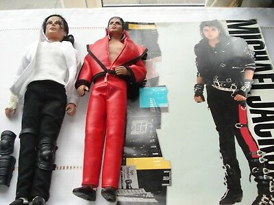 2 micheal jackson dolls  And tour programme