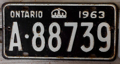 1963 White on Black Ontario License Plate with Crown