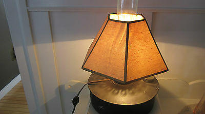 Primitive hurricane lamp from antique can. Black paint. Electric.