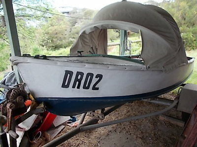 14 ft marine-ply boat on trailer. Perfect fix-me-up project. All unregistered