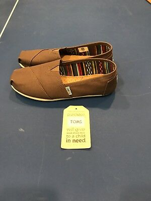 Toms Woman's size 7.5 tan Brown fabric New Without Box