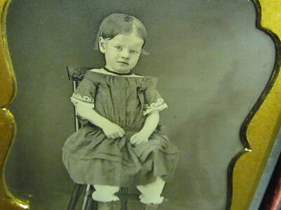 child sitting on a chair daguerreotype photograph