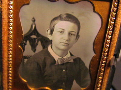 young boy daguerreotype photograph in thermoplastic case