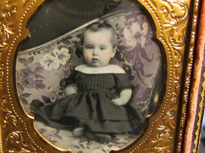 young child sitting on a victorian couch daguerreotype photograph