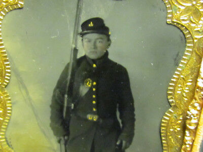 young Civil War soldier holding rifle at his side tintype photograph