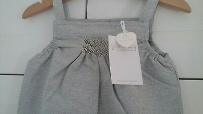 Sparkle smocked dungarees from the little white company. Size 9-12 months.
