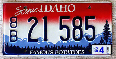 """1999 Red and White with Blue Mountains Idaho License Plate Version #2 """"8B"""""""