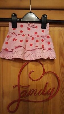 baby girls pink spotted skirt size 9-12 months
