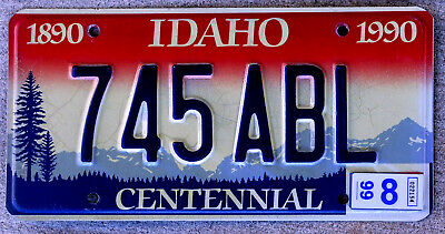 1999 Red & White with Blue Mountains Idaho CENTENNIAL License Plate Version #1