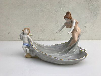 Porcelain Lady figurine drawn on her drag by a Putto, by Schierholz PMP Germany