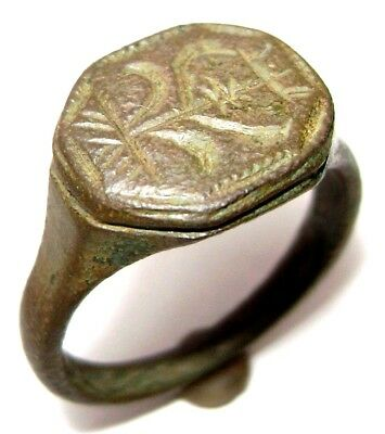 Ancient Rare Medieval  bronze ring seal with flower on bezel.