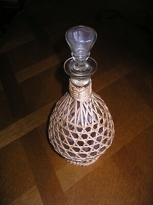 Glass wicker-covered carafe