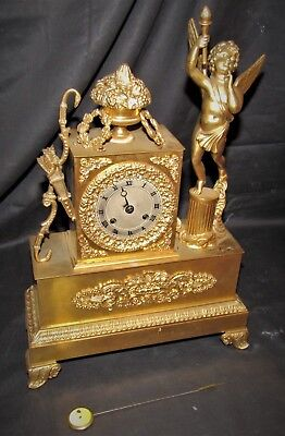 A Delightful & Early French Silk Empire Clock With Cherub Figure