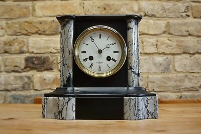 Striking French slate/marble mantle clock signed by Henri Marc