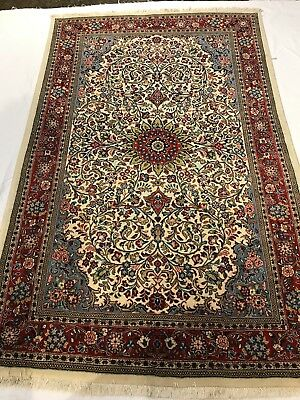 "Persian Sarouq. 4'5"" x 6'9"". Hand knotted in Iran. Semi Antique 100% Wool Pile"