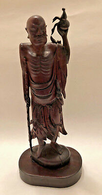 Chinese Boxwood Carving of an Old Man with Crutch holding a Groud