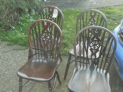 set of 4 vintage oak wheel back chairs.  £49 buys the set
