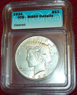 1934  Peace Dollar  Silver .900 Coin Icg Ms 60 Cleaned Beautiful  Rare Coin $1