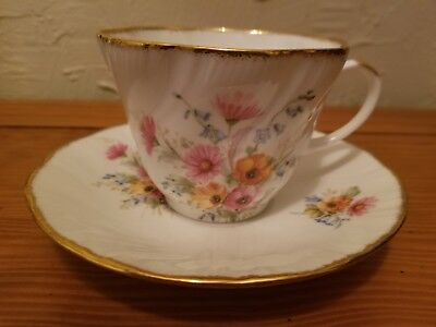 Royal Heritage Tea Cup and Saucer White with Multi-Colored Flowers made in Engla